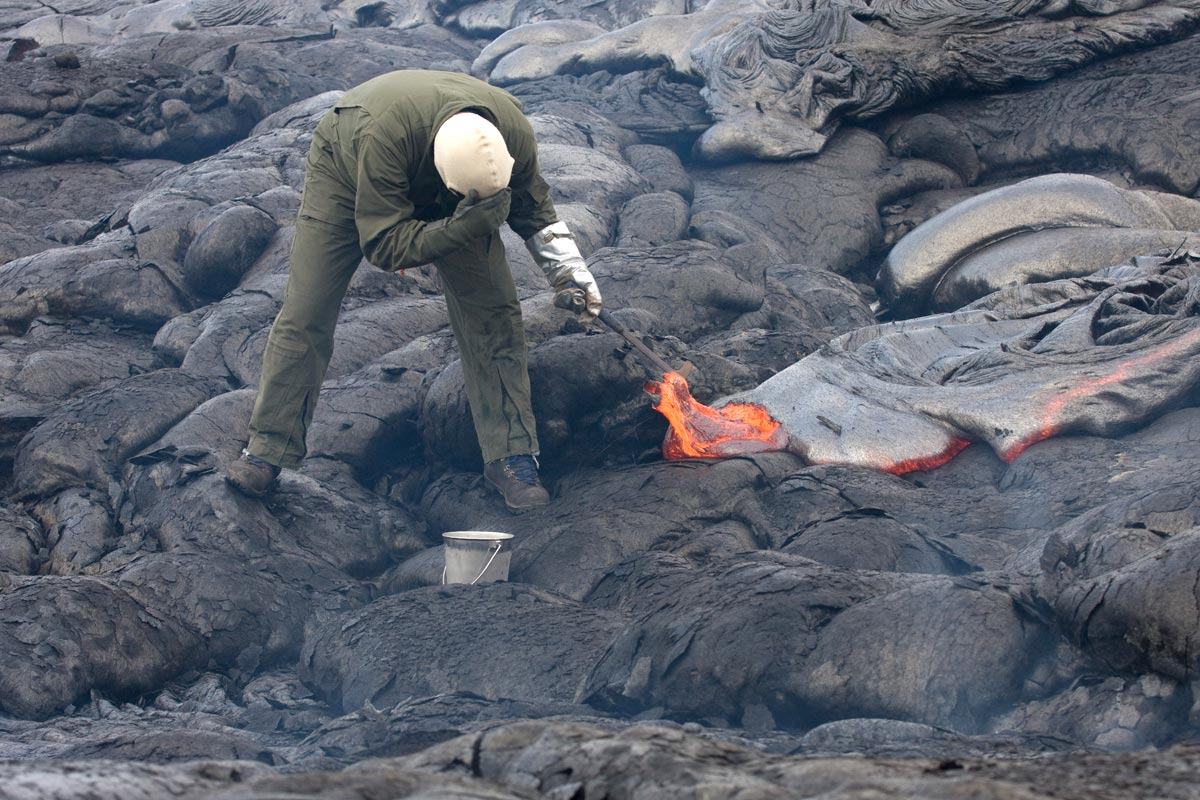 Taking a sample of lava at Kilauea